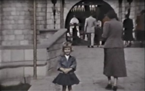 B/W photo of author Linda Needham as a 5 year old girl in the foreground, Sleeping Beauty's Castle, Disneyland, Anaheim, CA, in the background.